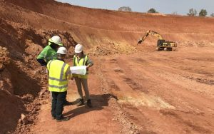 Team reviewing plans in the Komana East zone of Hummingbird Resources' Yanfolia gold project