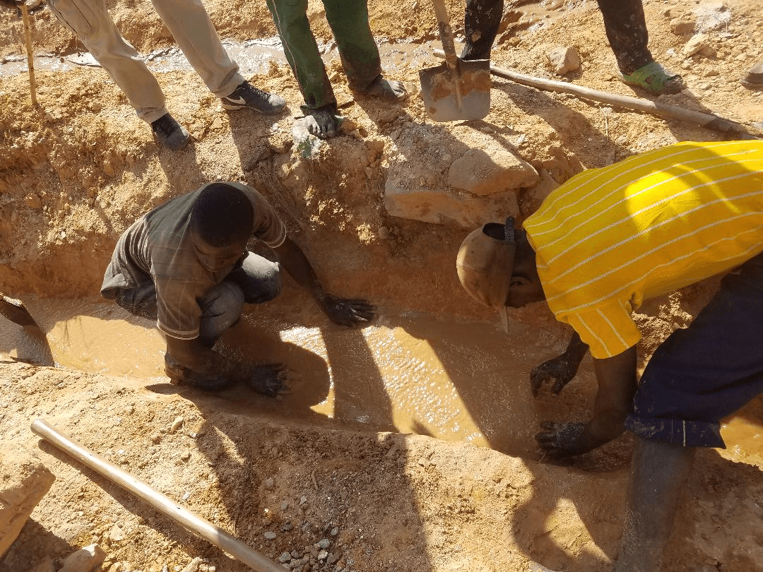 collected material is placed in a hand dug trench (Figure 2) and water is washed over it seperating the heavy tantalum and other metals from the light host minerals.