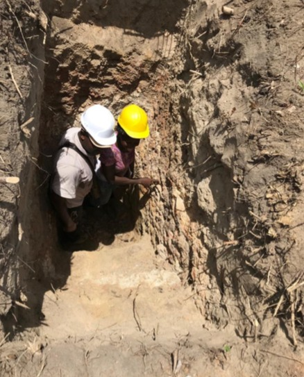 IronRidge Resources - geologists inspecting subcrop within a pit