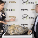 Mark Selby of RNC Minerals showing off a gold specimen from their Beta Hunt Mine at Mines and Money London 2018